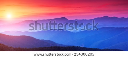 Red sunset in the mountains landscape with sunny beams. Dramatic scene. Carpathian, Ukraine, Europe. Beauty world. Retro style, vintage filter. Instagram toning effect. #234300205
