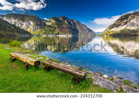 Wooden bench at mountain lake in the Alps #234312700