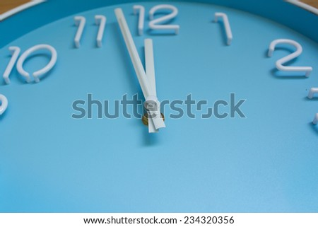 large clock blue face on wood background. #234320356