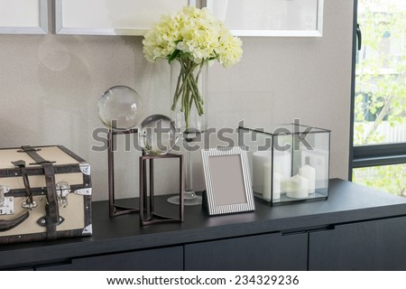 Picture frame and candle lamp on a table in a contemporary room