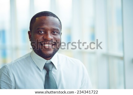 Portrait of a young cheerful businessman #234341722