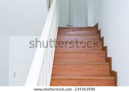 wooden staircase made from laminate wood in white modern house #234363988