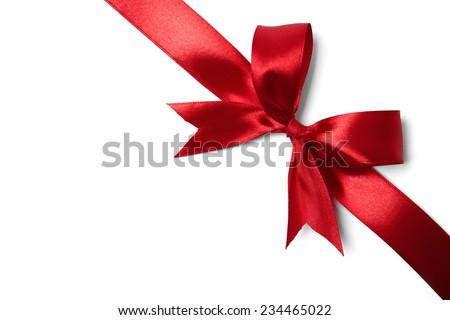 Red ribbon bow on white background. studio shot Royalty-Free Stock Photo #234465022