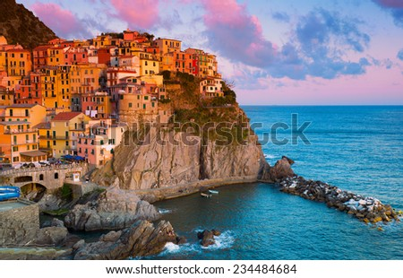 Picturesque view of Manarola, Laguria, Italy on a sunset #234484684