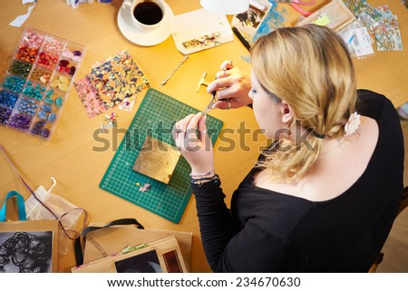 Overhead View Of Woman Making Jewelry At Home #234670630