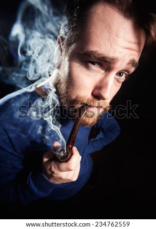 Funny handsome man smoking pipe. Toned photo, wide angle shoot. #234762559
