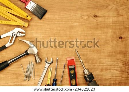 Assorted work tools on wood #234821023