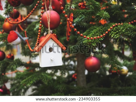 Christmas tree decoration wooden house ornament close up