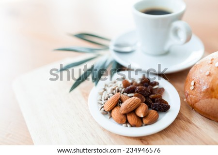 mixed nuts, bread and a cup of coffee #234946576
