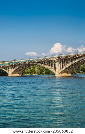 Metro Bridge is part of Brovary Parkway spanning across Dnipro River in Kyiv, capital of Ukraine. It was engineered by G. Fux and Y. Inosov and constructed in 1965 with expansion of Kyiv Metro system. #235063852