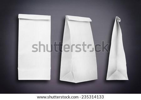 Paper bags on a chalkboard #235314133