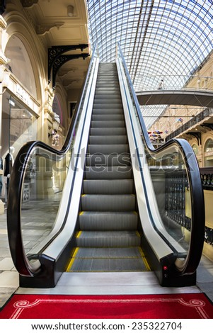 MOSCOW - MAY 18, 2014: Escalator in the Main Universal Store (GUM). This is the large store in the Kitay-gorod district facing Red Square. It is still a shopping mall. #235322704