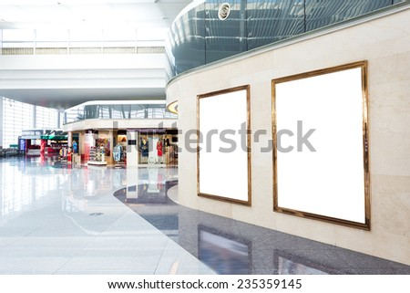 blank poster board wall in modern shopping mall
