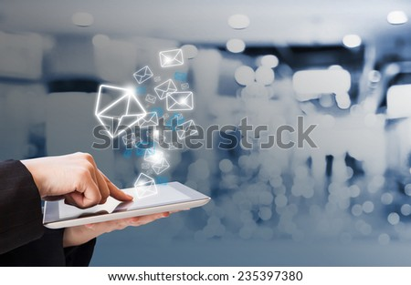 Business woman sending email in the shopping mall  #235397380