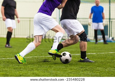 football soccer game. competition between two running players footballers #235480228