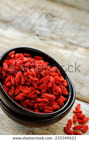 Goji berries on white wood background. tinting. selective focus #235549621