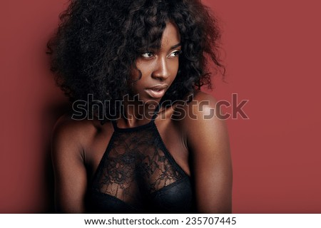 pretty black woman with ideal skin on a black background #235707445