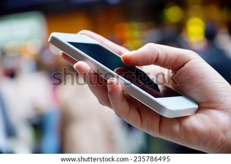 Teenage girl text messaging on her phone  #235786495