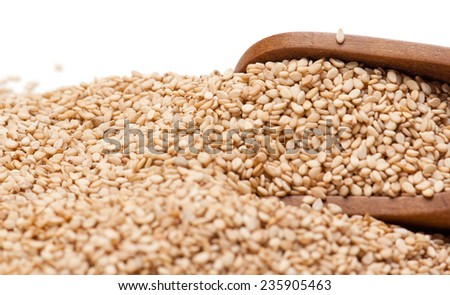 Sesame Seeds and wooden scoop isolated on white background #235905463