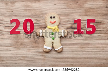 Christmas 2015 cookie with homemade christmas painted ginger-breads (gingerbread man) on the wooden background
