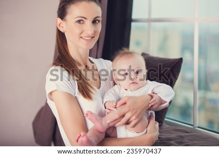 Newborn baby with his young mother #235970437