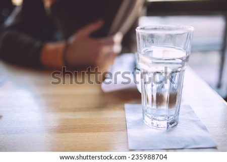 Glass of water and a man on a background #235988704