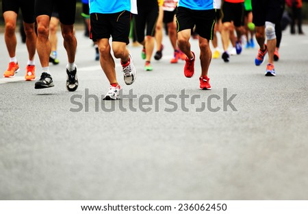 Unidentified marathon athletes legs running on  city road  #236062450