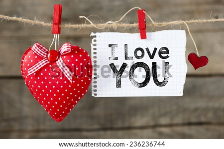 """I Love You background. """"I Love You"""". heart and note with words """"I Love You"""". On old wood background."""