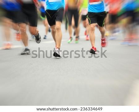 Unidentified marathon athletes legs running on  city road  #236334649