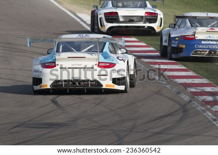 Imola, Italy - October 11, 2014: A Porsche 997 Gt3 of Ebimotors team, driven By Gagliardini Andrea (Ita) and Donativi Vincenzo (Ita) ,the C.I. Gran Turismo car racing. #236360542