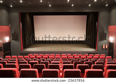 Empty cinema auditorium with line of chairs and stage with silver screen. Ready for adding your own picture. #23637856