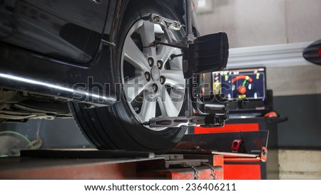Car on stand with sensors on wheels for wheels alignment camber check in workshop of Service station. #236406211