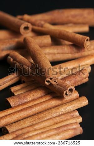 Cinnamon sticks on the black background #236716525