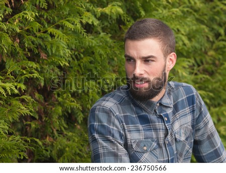 Hipster man looking aside in a park outdoors #236750566
