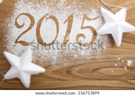 2015 inscription on the wooden background with two white stars #236753899