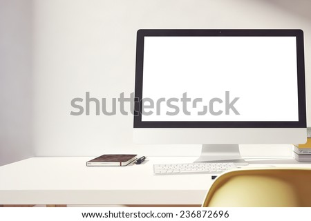 the computer is on the table in a bright interior #236872696