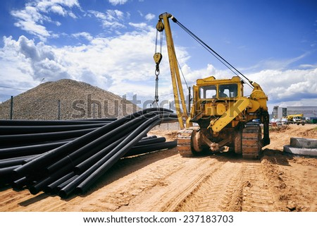Construction works, construction machinery, bulldozer, excavation, factory Royalty-Free Stock Photo #237183703