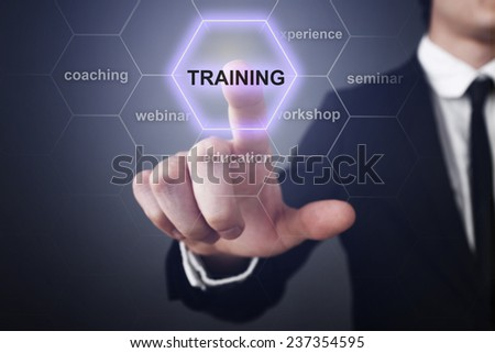 Businessman pressing touch screen interface and select icon training #237354595