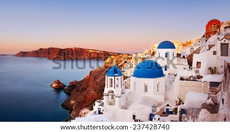 Oia at sunrise with caldera view in Santorini, Greece. Focus on Blue Domes. #237428740