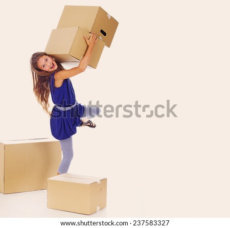 Portrait of little kid posing in studio with a lot of cardboards #237583327