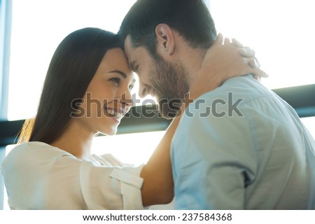 I love you so much! Beautiful young loving couple bonding to each other and smiling while woman embracing her boyfriend