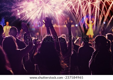 New Year concept - cheering crowd and fireworks  Royalty-Free Stock Photo #237584965
