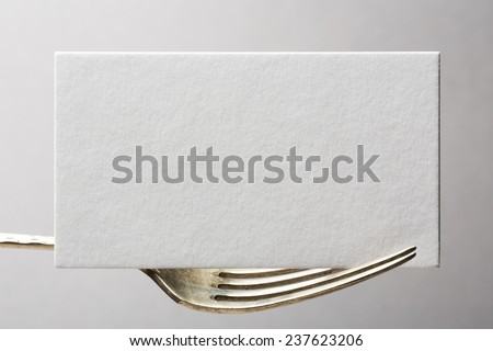 blank business card or invitation on fork