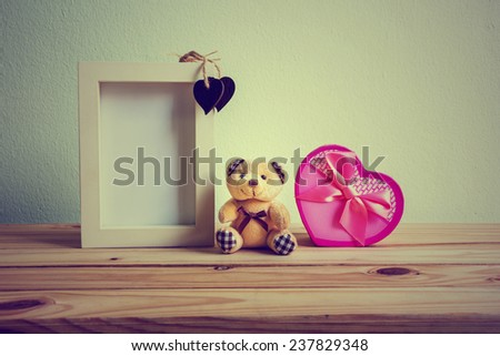 Still life with gift box on wooden table over grunge background, Valentine concept