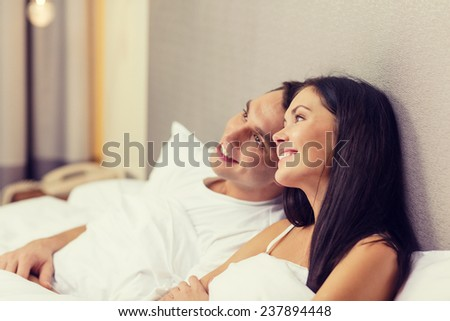hotel, travel, relationships, and happiness concept - happy couple dreaming in bed #237894448