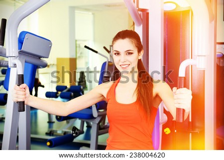 Beautiful woman training with weights in gym #238004620