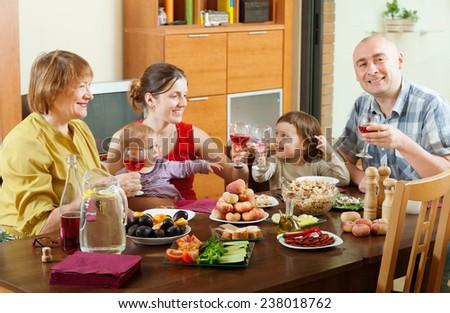 happy multigeneration family communicate around festive table   #238018762