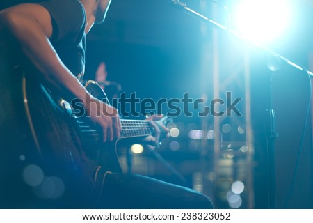 Guitarist on stage for background, soft and blur concept Royalty-Free Stock Photo #238323052