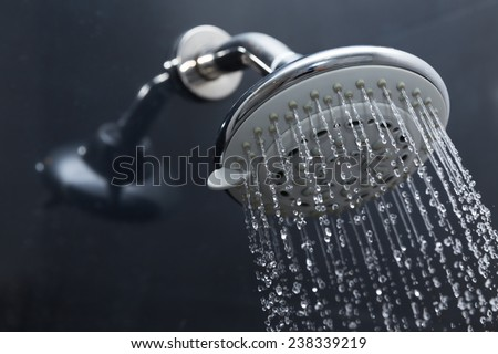 shower head in bathroom with water drops flowing Royalty-Free Stock Photo #238339219