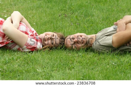 Young couple on the grass #23836708